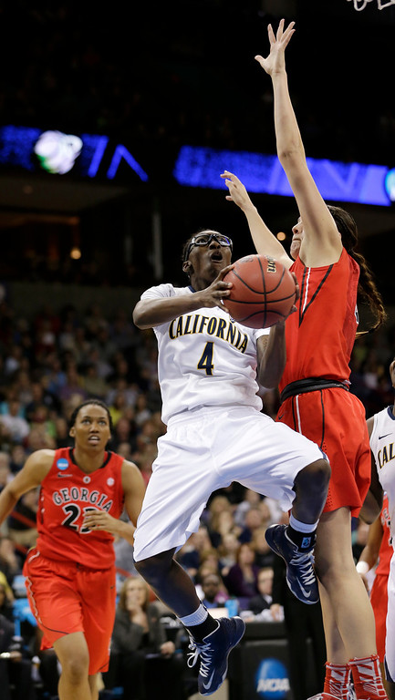 . California\'s Eliza Pierre (4) drives against Georgia\'s Anne Marie Armstrong during the second half in a regional final in the NCAA women\'s college basketball tournament, Monday, April 1, 2013, in Spokane, Wash. (AP Photo/Elaine Thompson)