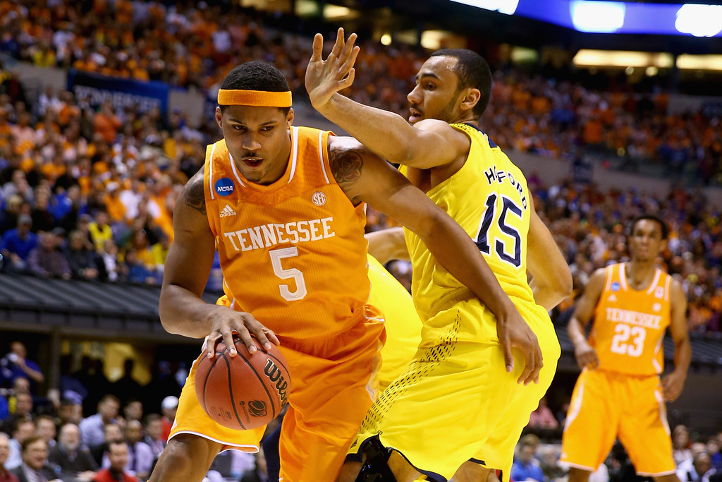 . Jarnell Stokes #5 of the Tennessee Volunteers drives to the basket against Jon Horford #15 of the Michigan Wolverines during the regional semifinal of the 2014 NCAA Men\'s Basketball Tournament at Lucas Oil Stadium on March 28, 2014 in Indianapolis, Indiana.  (Photo by Andy Lyons/Getty Images)