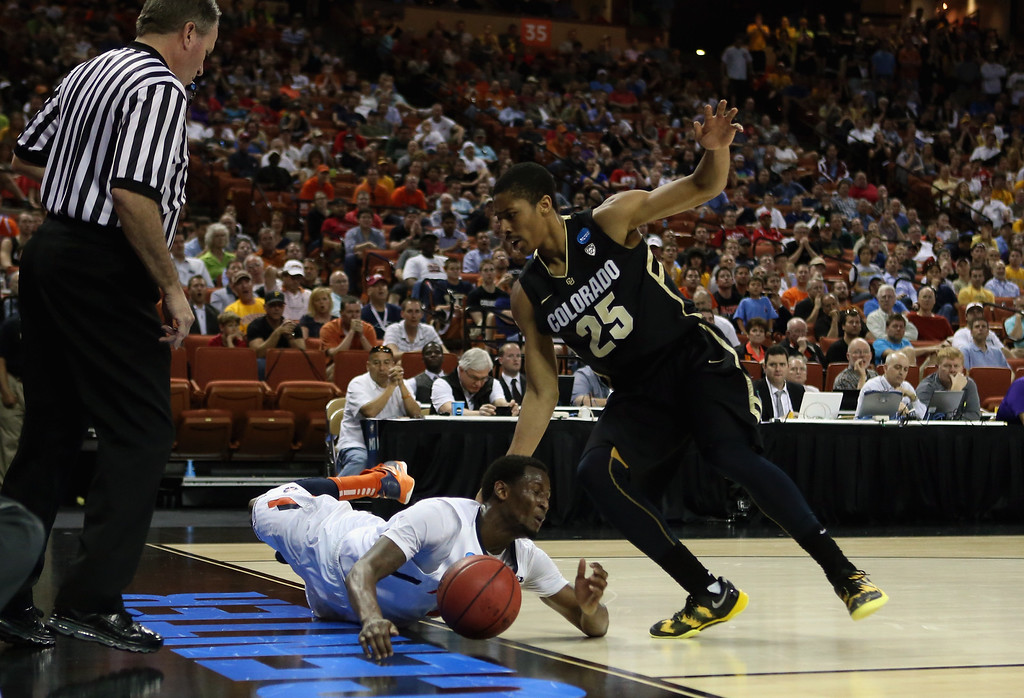 . AUSTIN, TX - MARCH 22:  D.J. Richardson #1 of the Illinois Fighting Illini falls out of bounds while dribbling against Spencer Dinwiddie #25 of the Colorado Buffaloes  during the second round of the 2013 NCAA Men\'s Basketball Tournament at The Frank Erwin Center on March 22, 2013 in Austin, Texas.  (Photo by Ronald Martinez/Getty Images)