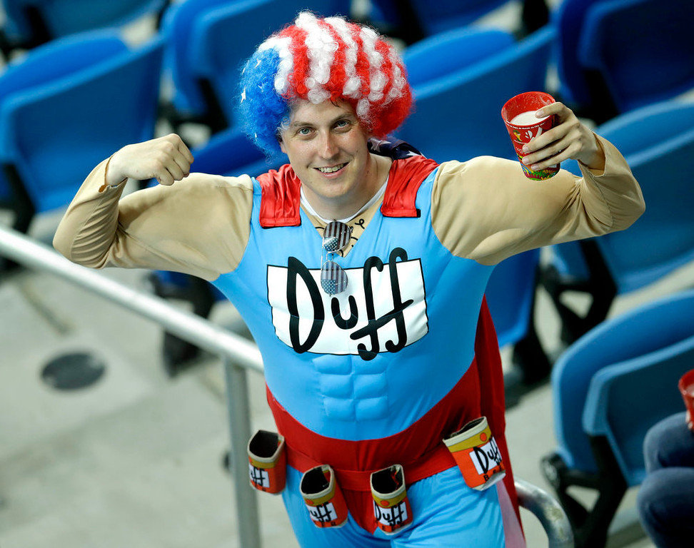 . A United States supporter poses for a photo before the group G World Cup soccer match between Ghana and the United States at the Arena das Dunas in Natal, Brazil, Monday, June 16, 2014. (AP Photo/Hassan Ammar)