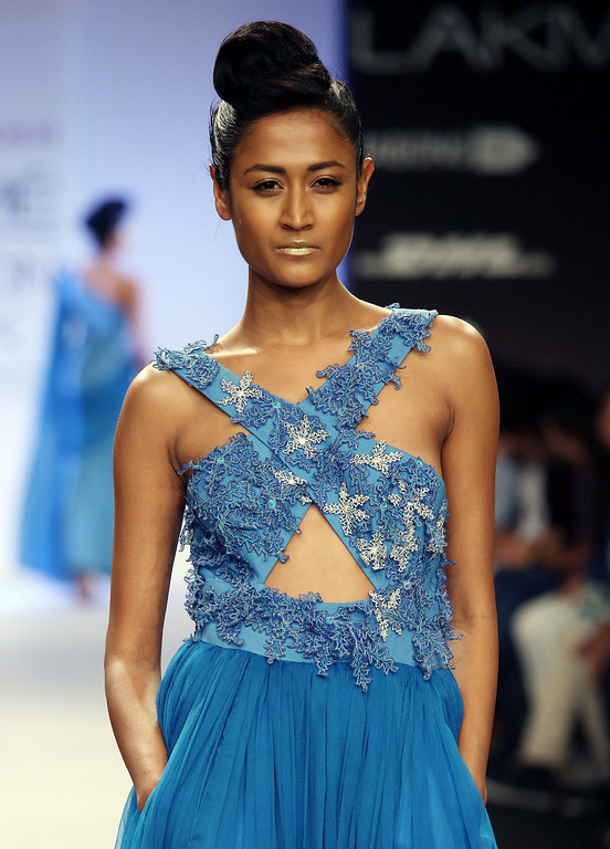. A model presents a creation by Indian designer Abdul Halder during the Lakme Fashion Week Summer/Resort 2014 in Mumbai, India, 13 March 2014. Some 92 designers will be showcasing their collections during the event running from 12 to 16 March.  EPA/DIVYAKANT SOLANKI