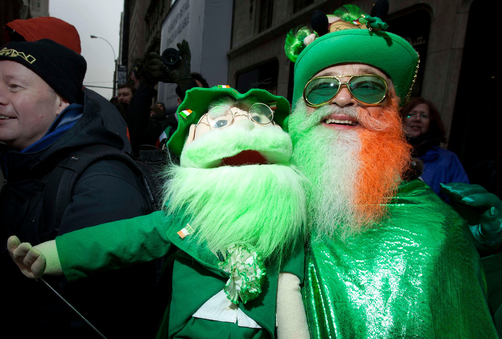 . Dennis O\'Mann and his doll watch the St. Patrick\'s Day Parade in New York, March 16, 2013.  REUTERS/Carlo Allegri