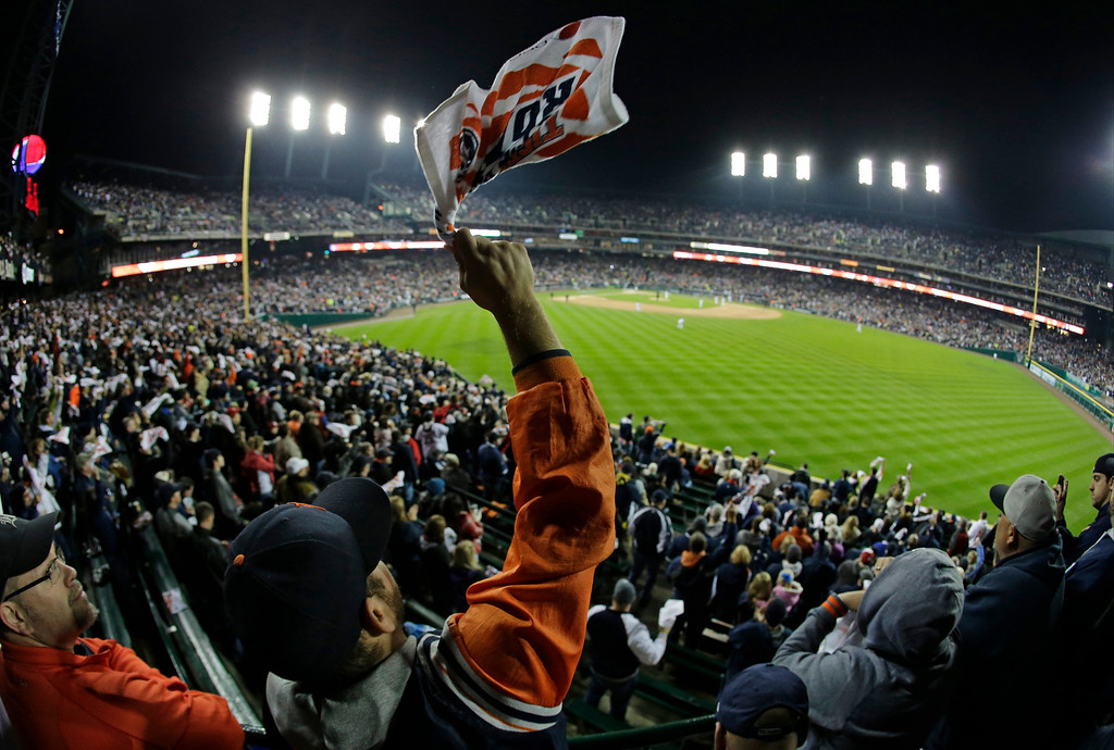 . A Detroit Tigers fan cheers before the start of Game 5 of the American League baseball championship series against the Boston Red Sox, Thursday, Oct. 17, 2013, in Detroit. (AP Photo/Charlie Riedel)