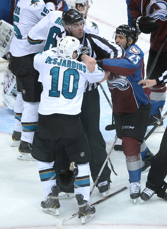 . DENVER, CO. - JANUARY 04:  Maxime Talbot and Andrew Desjardins found a reason to go at it in the second period. The Colorado Avalanche hosted the San Jose Sharks at the Pepsi Center Saturday afternoon, January 4, 2014. Photo By Karl Gehring/The Denver Post