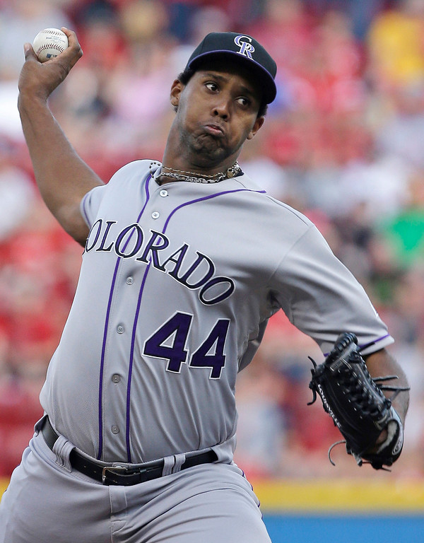 . Colorado Rockies starting pitcher Juan Nicasio throws against the Cincinnati Reds in the first inning of a baseball game, Tuesday, June 4, 2013, in Cincinnati. (AP Photo/Al Behrman)