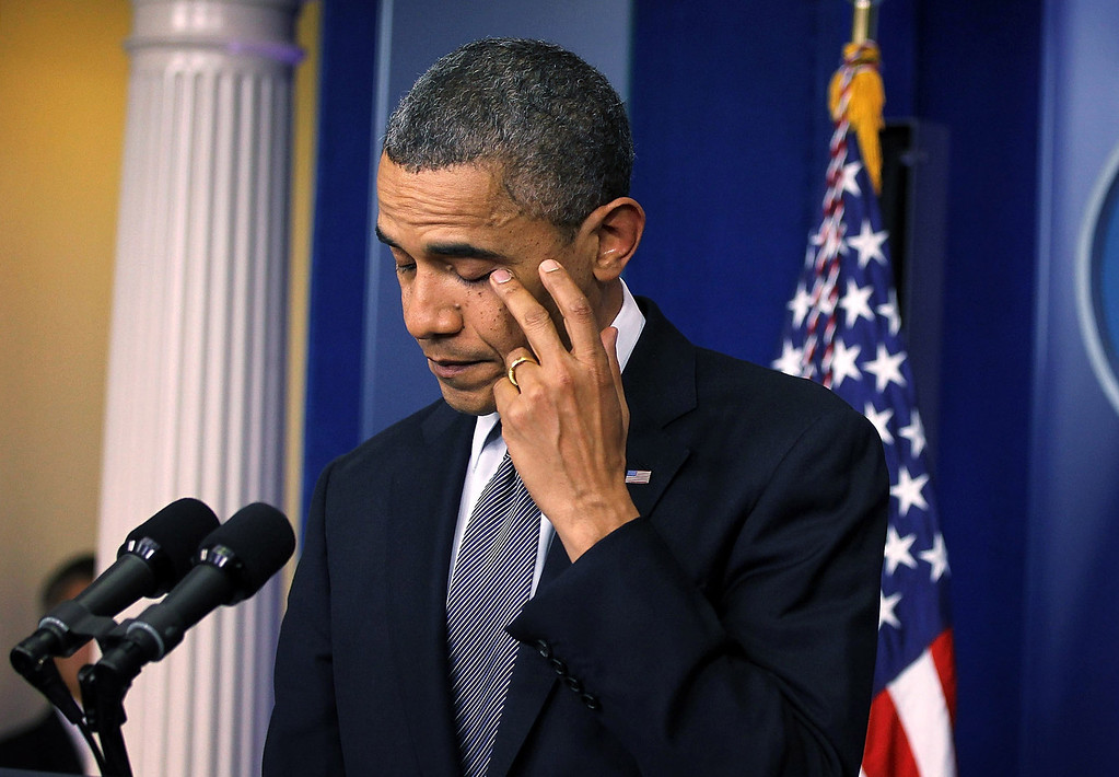 . U.S. President Barack Obama wipes tears as he makes a statement in response to the elementary school shooting in Connecticut December 14, 2012 at the White House in Washington, DC. According to reports, there are 27 dead, including the shooter, 20 of them children, after Ryan Lanza, 24, opened fire in at the Sandy Hook Elementary School in Newtown, Connecticut. Reports say that Lanza was dead at the scene and his mother, a teacher at the school, is also dead. His brother has also been found dead in Hoboken, New Jersey.  (Photo by Alex Wong/Getty Images)
