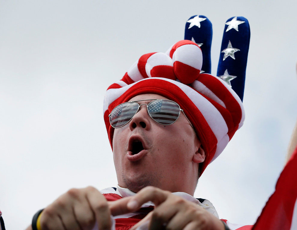 . Rick Pusateri cheers for the United States team as they tee off on the first hole during a foursome match at the Presidents Cup golf tournament at Muirfield Village Golf Club, Friday, Oct. 4, 2013, in Dublin, Ohio. (AP Photo/Darron Cummings)