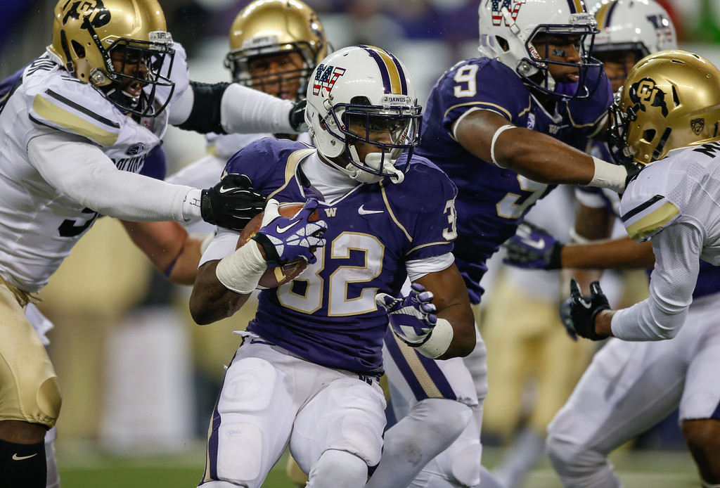. Running back Deontae Cooper #32 of the Washington Huskies rushes against the Colorado Buffaloes on November 9, 2013 at Husky Stadium in Seattle, Washington. The Huskies defeated the Buffaloes 59-7.  (Photo by Otto Greule Jr/Getty Images)