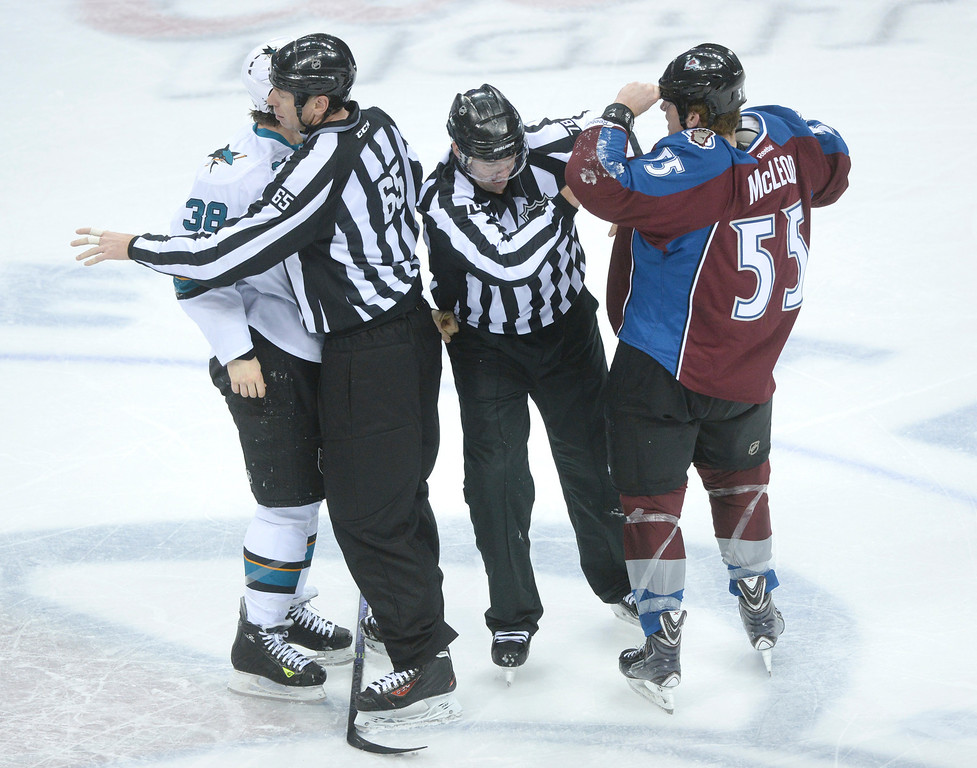 . DENVER, CO. - JANUARY 04:  Officials separated Sharks\' wing Bracken Kearns and Avs\' wing Cody McLeod in the second period. The Colorado Avalanche hosted the San Jose Sharks at the Pepsi Center Saturday afternoon, January 4, 2014. Photo By Karl Gehring/The Denver Post