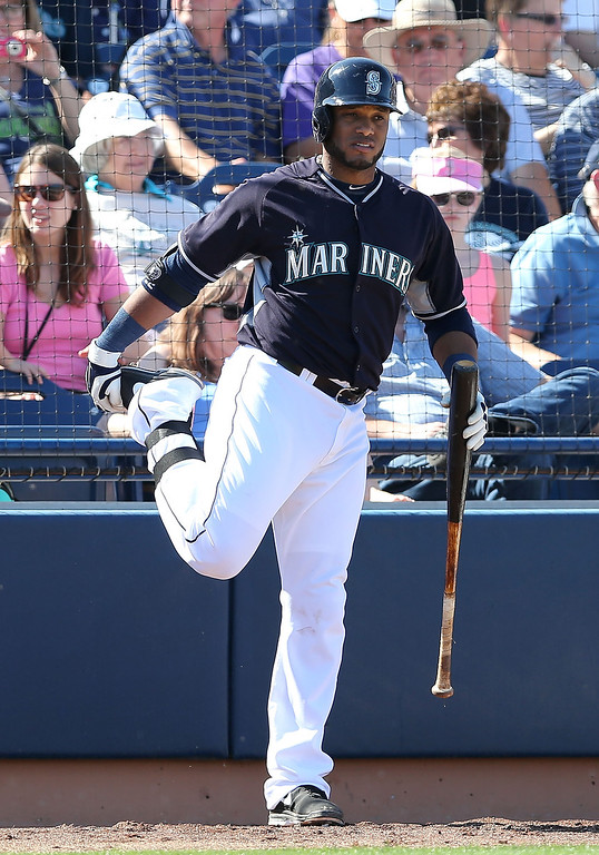 . Robinson Cano #22 of the Seattle Mariners warms up on deck during the spring training game against the Colorado Rockies at Peoria Stadium on March 3, 2014 in Peoria, Arizona.  (Photo by Christian Petersen/Getty Images)