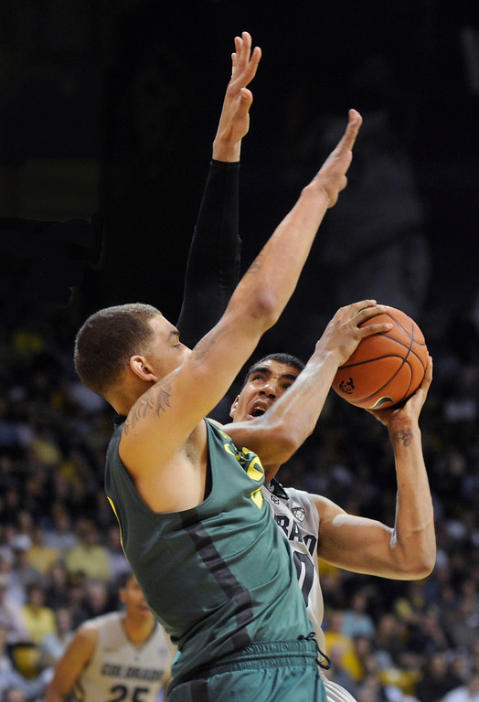 . BOULDER, CO. - MARCH 7: Colorado center Josh Scott (40) worked against Oregon center Waverly Austin (20) in the second half. The University of Colorado men\'s basketball team defeated Oregon 76-53 Thursday night, March 7, 2013 at the CU Events Center in Boulder. (Photo By Karl Gehring/The Denver Post)