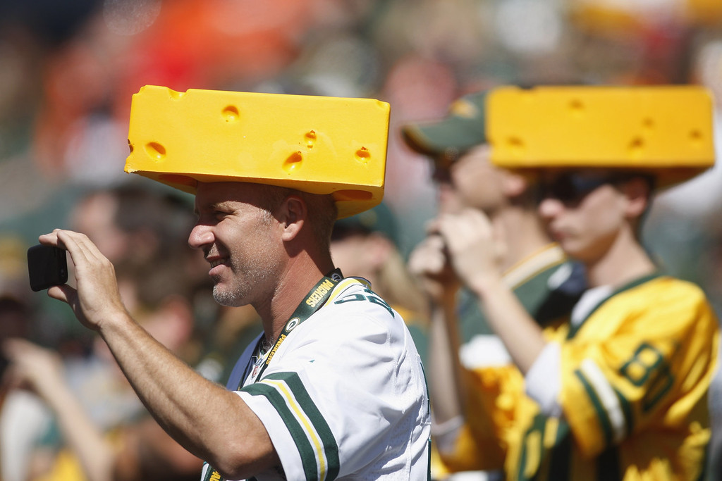 . Green Bay Packers fans take pictures of their team before the start of the game against the Cincinnati Bengals at Paul Brown Stadium on September 22, 2013 in Cincinnati, Ohio.  (Photo by John Grieshop/Getty Images)
