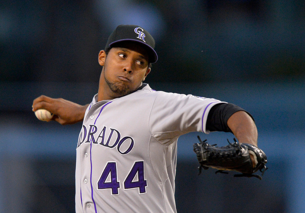 . Colorado Rockies starting pitcher Juan Nicasio throws to the plate during the first inning of their baseball game against the Los Angeles Dodgers, Wednesday, May 1, 2013, in Los Angeles. (AP Photo/Mark J. Terrill)