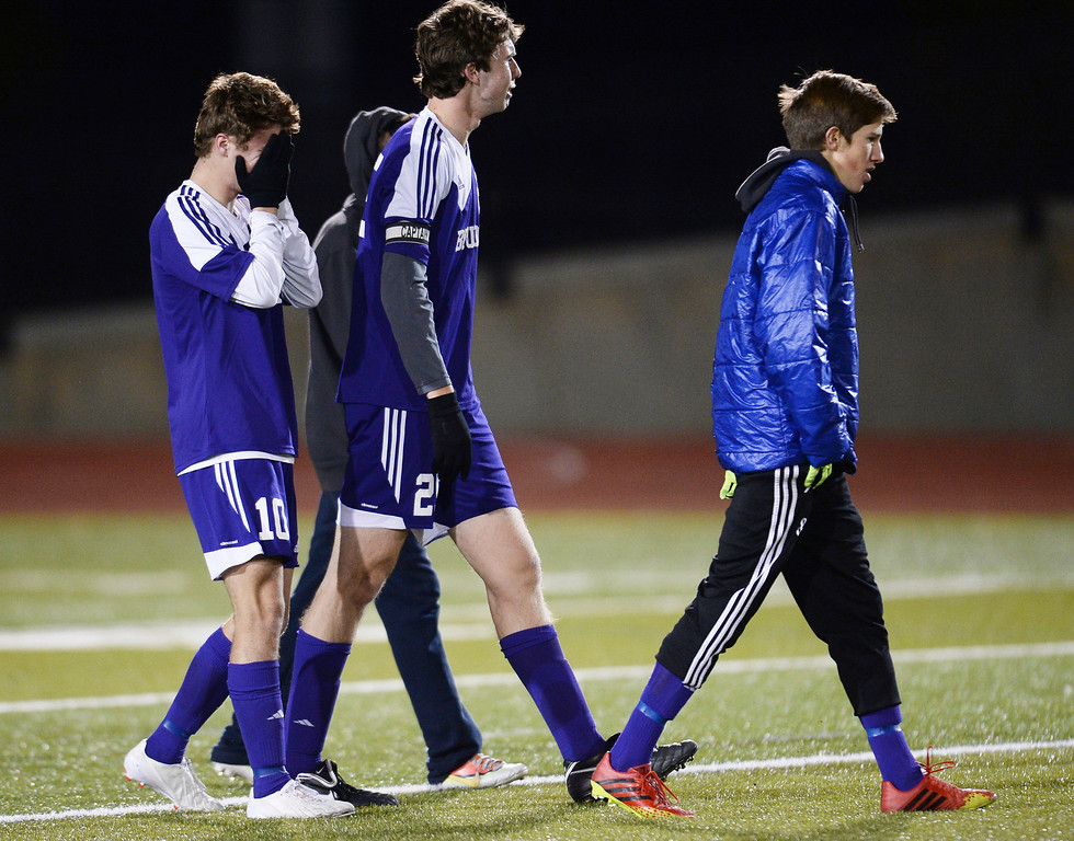 . Quinn Liebmann (10), Ryan Bower (25) of Boulder High School and the teammates are leaving the field after losing 5A semifinal game 1-0 against Pine Creek High School. (Photo by Hyoung Chang/The Denver Post)