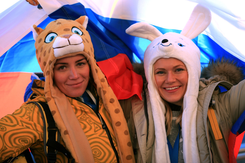 . Spectators pose as they arrive for the Opening Ceremony of the Sochi 2014 Winter Olympics at Fisht Olympic Stadium on February 7, 2014 in Sochi, Russia.  (Photo by Richard Heathcote/Getty Images)