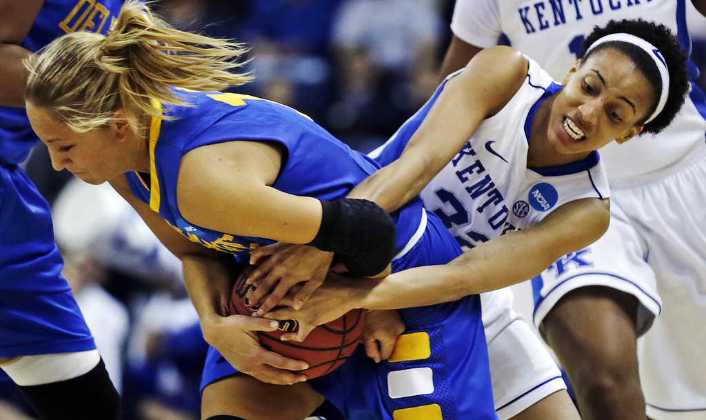 . Kentucky guard Kastine Evans, right, wrestles Delaware guard Kayla Miller for the ball during the first half of a regional semifinal in the NCAA college basketball tournament in Bridgeport, Conn., Saturday, March 30, 2013. (AP Photo/Charles Krupa)