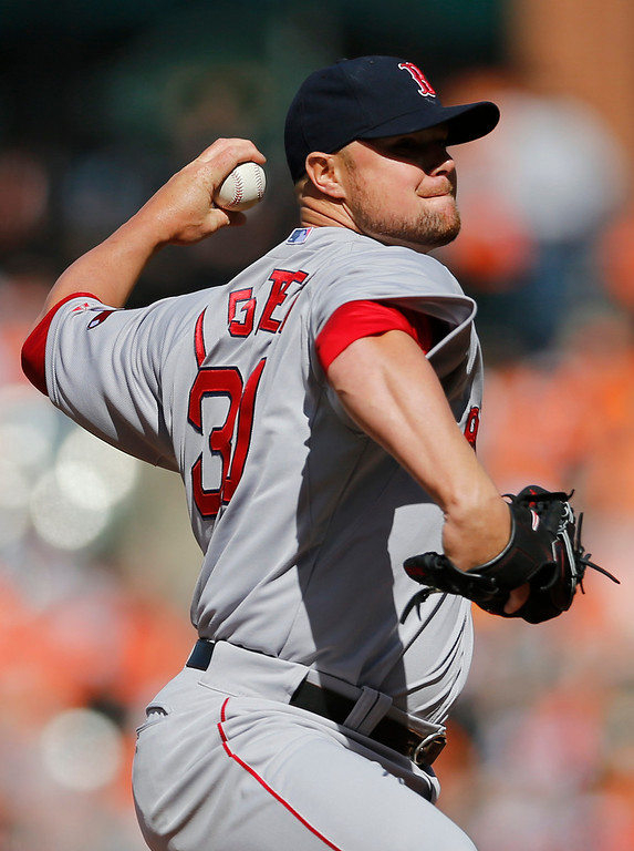 . Boston Red Sox starting pitcher Jon Lester throws to the Baltimore Orioles in the first inning of an opening day baseball game, Monday, March 31, 2014, in Baltimore. (AP Photo/Patrick Semansky)