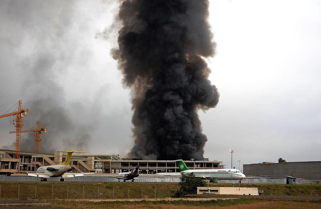 . Black smoke billows from the burning Jomo Kenyatta international airport in Nairobi on August 7, 2013. AFP PHOTO/StringerSTRINGER/AFP/Getty Images