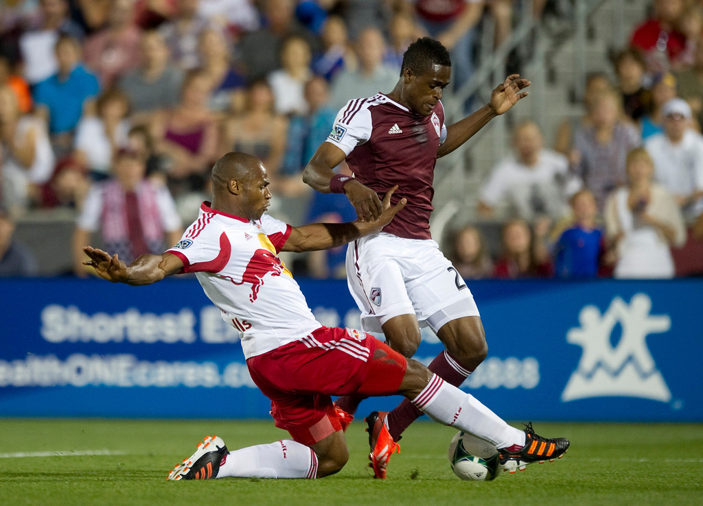 . DENVER - JULY 4: Deshorn Brown #26 of the Colorado Rapids, makes an attempt on the goal against #4 of the New York Red Bulls Jamison Olave during the second half of a MLS soccer match against the New York Red Bulls on July 4, 2013 at Dick\'s Sporting Goods Park. The Rapids defeated the Red Bulls 2-0.(Photo By Grant Hindsley / The Denver Post)