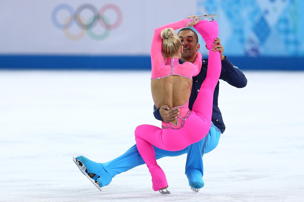 Description of . Aliona Savchenko and Robin Szolkowy of Germany compete during the Figure Skating Pairs Short Program on day four of the Sochi 2014 Winter Olympics at Iceberg Skating Palace on February 11, 2014 in Sochi, Russia.  (Photo by Paul Gilham/Getty Images)