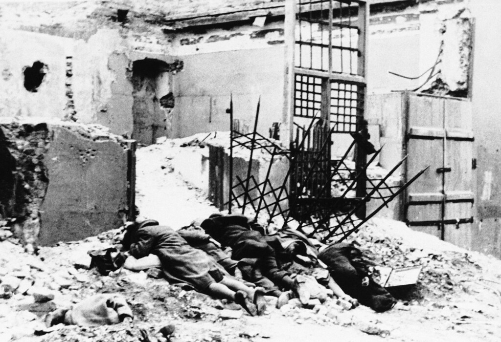 . **EDS NOTE: GRAPHIC CONTENT** The dead lie in the ruins of the Warsaw Ghetto in Poland, which was destroyed by the Nazis in the spring of 1943.  (AP Photo)