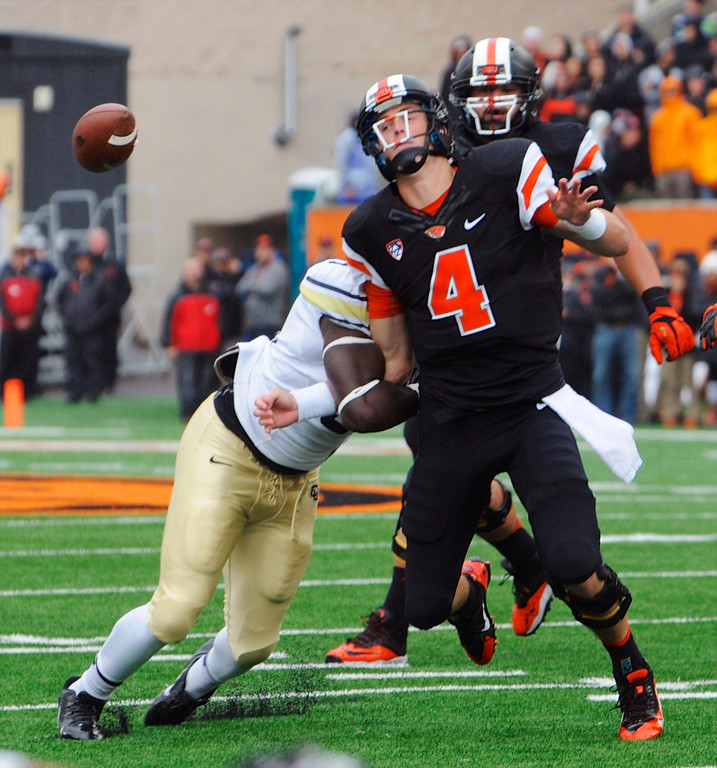 . Oregon State\'s quarterback Sean Mannion (4) loses the ball in a tackle by Colorado\'s Chidera Uzo-Diribe (96) in the first half of an NCAA college football game on Saturday, Sept 28, 2013, in Corvallis, Ore. (AP Photo/Greg Wahl-Stephens)