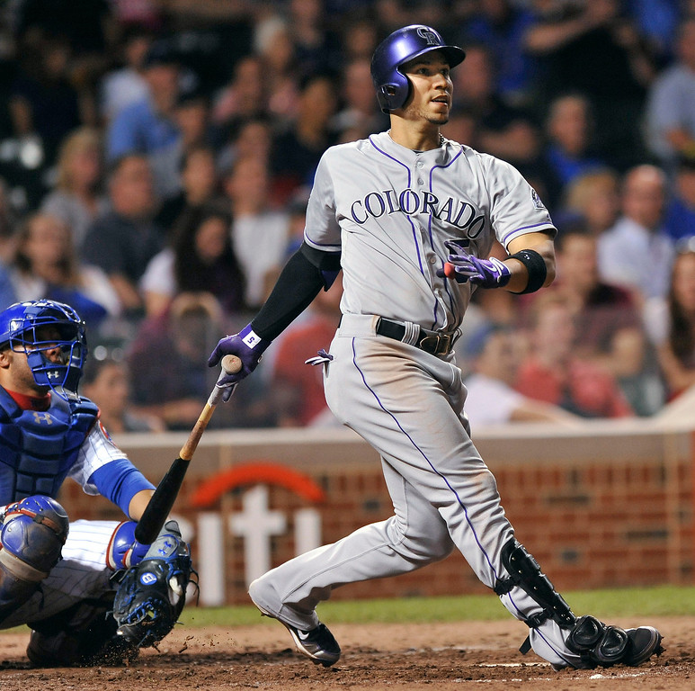 . Colorado Rockies\' Carlos Gonzalez watches his solo home run during the eighth inning of a baseball game against the Chicago Cubs in Chicago, Tuesday, May 14, 2013. (AP Photo/Paul Beaty)