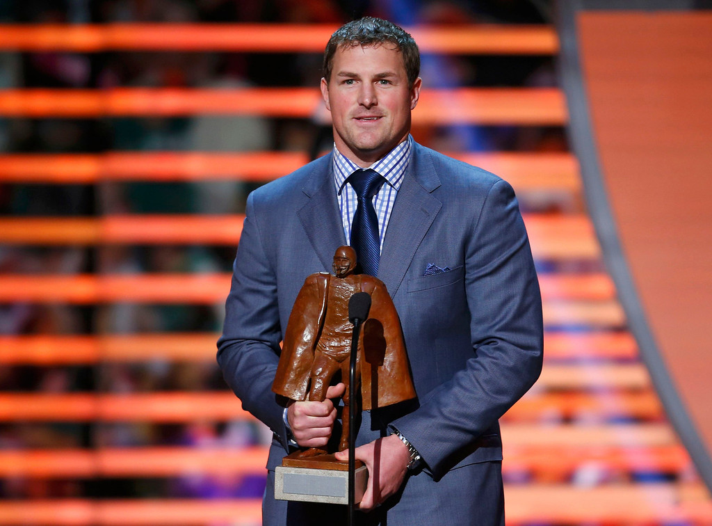 . Dallas Cowboys Jason Witten holds the Walter Payton Man of the Year Award after it was presented to him during the NFL Honors award show in New Orleans, Louisiana February 2, 2013.  REUTERS/Jeff Haynes