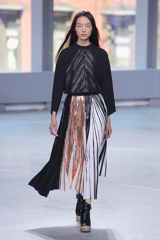 . A model walks the runway at the Proenza Schouler fashion show during Mercedes-Benz Fashion Week Spring 2014 at Skylight Ltd on September 11, 2013 in New York City.  (Photo by Peter Michael Dills/Getty Images)