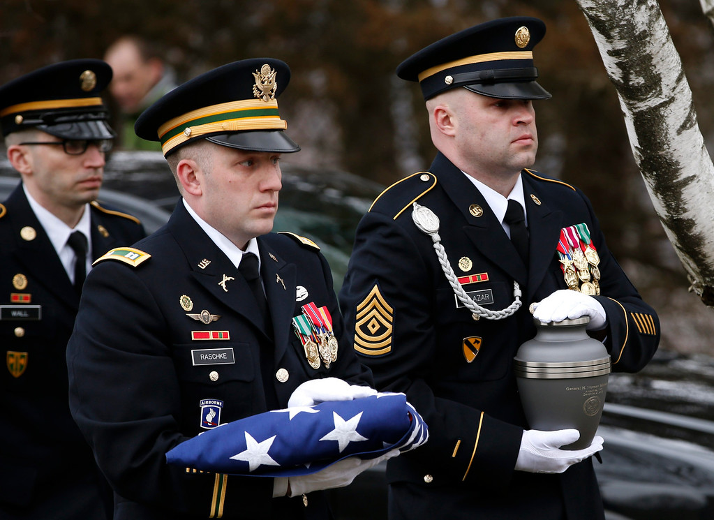 . A U.S. Army Honor Guard soldier (R) carries the cremated remains of U.S. Four Star General H. Norman Schwarzkopf to his burial service at the United States Military Academy at West Point, New York, February 28, 2013. REUTERS/Mike Segar