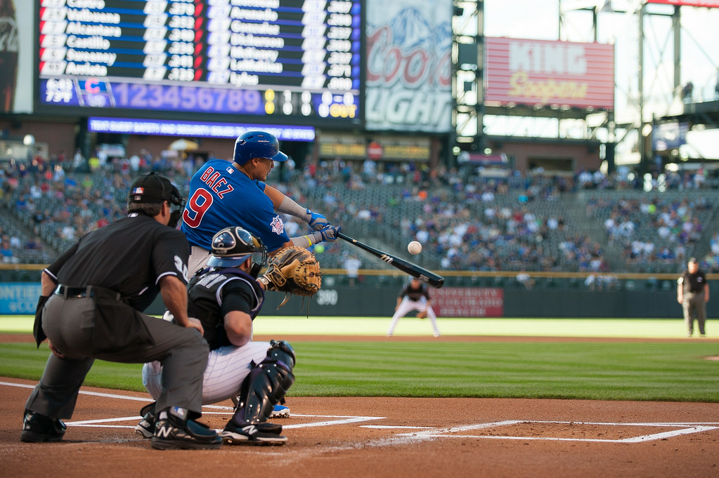 . DENVER, CO - AUGUST 06:  Javier Baez #9 of the Chicago Cubs pops out in the first inning of a game against the Colorado Rockies at Coors Field on August 6, 2014 in Denver, Colorado.  (Photo by Dustin Bradford/Getty Images)
