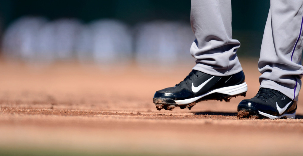 . SCOTTSDALE, AZ. - FEBRUARY 23: Michael Cuddyer (3) of the Colorado Rockies cleats were caked with dirt in their game against the Arizona Diamondbacks February 23, 2013 in Scottsdale. The field took on heavy water after the snow storm early in the week. (Photo By John Leyba/The Denver Post)