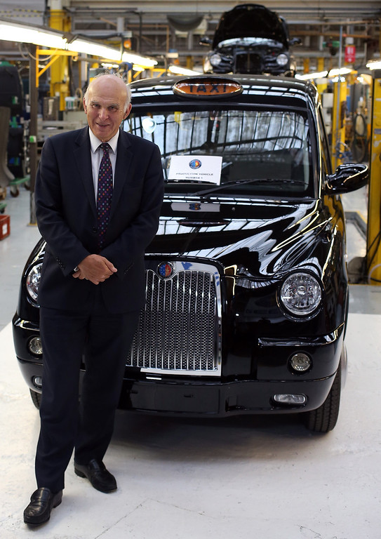 . Business secretary, Vince Cable stands besides a brand new TX4 (Euro 5) London Taxis inside the factory of The London Taxi Company on September 11, 2013 in Coventry, England.  (Photo by Matt Cardy/Getty Images)