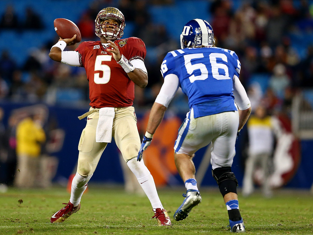 . Quarterback Jameis Winston #5 of the Florida State Seminoles is pressured by linebacker Kyler Brown #56 of the Duke Blue Devils during the ACC Championship game at Bank of America Stadium on December 7, 2013 in Charlotte, North Carolina.  (Photo by Streeter Lecka/Getty Images)