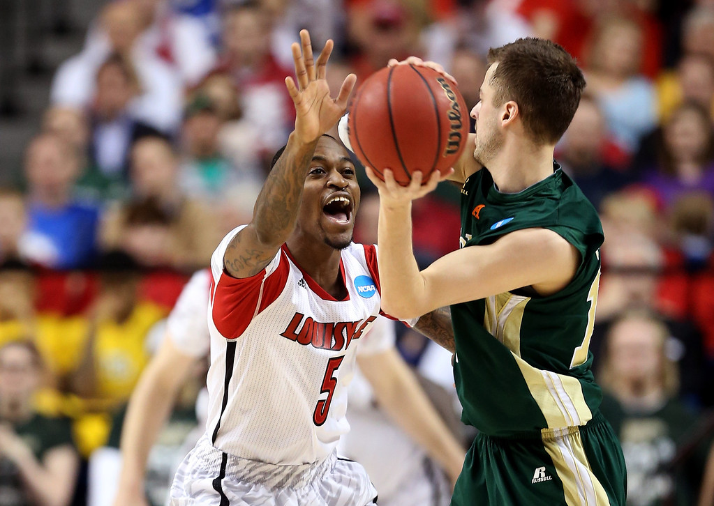 . LEXINGTON, KY - MARCH 23: Kevin Ware #5 of the Louisville Cardinals defends Wes Eikmeier #10 of the Colorado State Rams in the second half during the third round of the 2013 NCAA Men\'s Basketball Tournament at Rupp Arena on March 23, 2013 in Lexington, Kentucky.  (Photo by Andy Lyons/Getty Images)