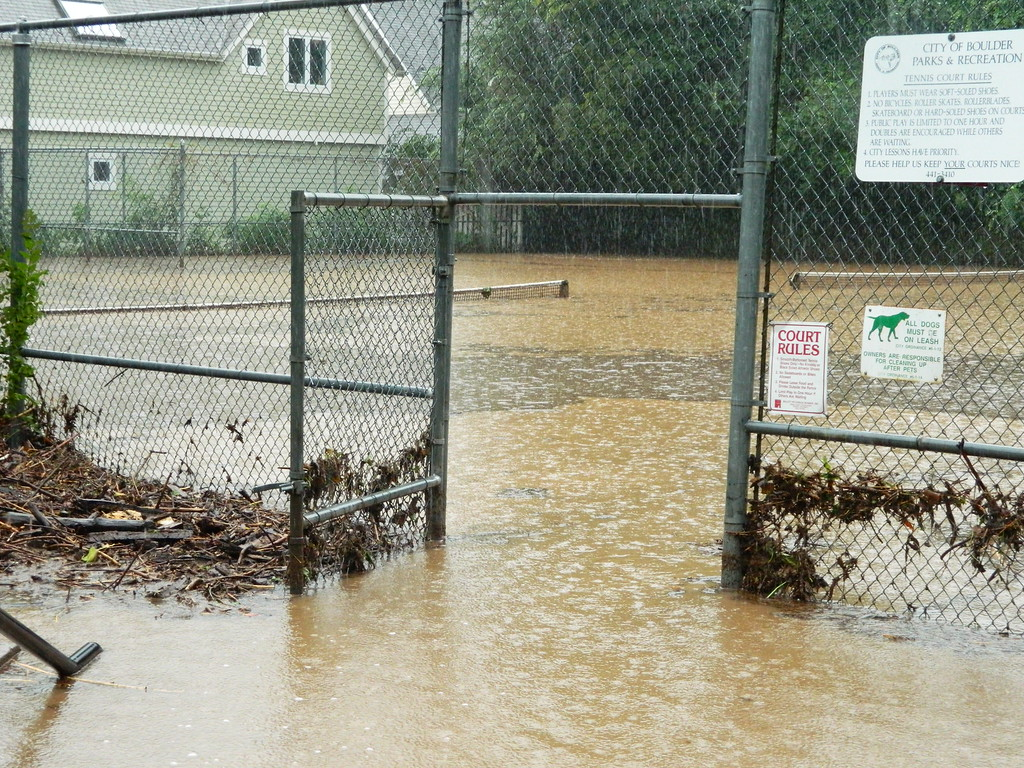 . Tennis courts by Pearl and 2nd St in Boulder became a muddy pond. Photo by Jae Beaubier