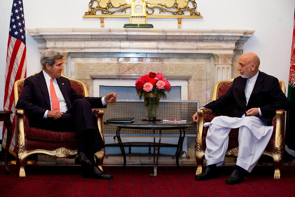 . U.S. Secretary of State John Kerry, left, meets with Afghan President Hamid Karzai at the Presidential Palace during an unannounced stop in Kabul, Afghanistan, Friday, Oct. 11, 2013. Kerry flew to Afghanistan Friday for urgent talks with Afghan President Hamid Karzai as an end of October deadline looms for completing a security deal that would allow American troops to remain in Afghanistan after the end of the NATO-led military mission next year. (AP Photo/Jacquelyn Martin, Pool)