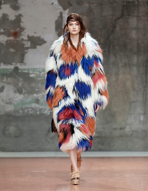 . A model wears a creation for Marni women\'s Fall-Winter 2014-15 collection, part of the Milan Fashion Week, unveiled in Milan, Italy, Sunday, Feb. 23, 2014. (AP Photo/Antonio Calanni)