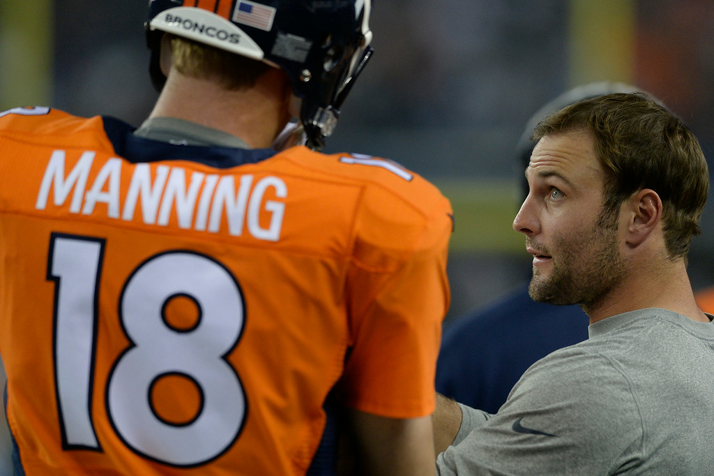 . ARLINGTON, TX - AUGUST 28: Denver Broncos quarterback Peyton Manning (18) talks with Denver Broncos wide receiver Wes Welker on the sidelines during their game against the Dallas Cowboys August 28, 2014 at AT&T Stadium. (Photo by John Leyba/The Denver Post)