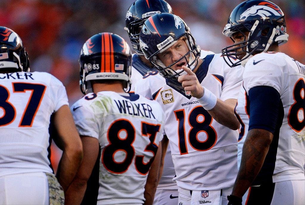 . Quarterback Peyton Manning #18 of the Denver Broncos talking to his receivers in the huddle during the 3rd quarter vs the San Diego Chargers at Qualcomm Stadium November 10, 2013 San Diego, CA. (Photo By Joe Amon/The Denver Post)
