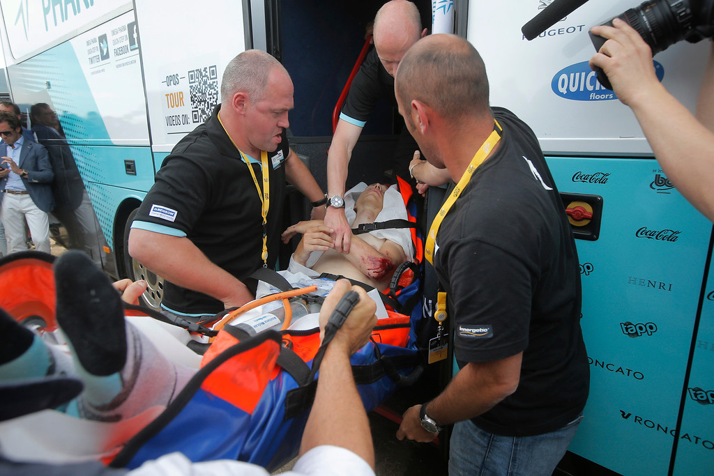 . Tony Martin of Germany is taken to an ambulance on the finish line after crashing in the first stage of the Tour de France cycling race over 213 kilometers (133 miles) with start in Porto Vecchio and finish in Bastia, Corsica island, France, Saturday June 29, 2013. (AP Photo/Laurent Cipriani)