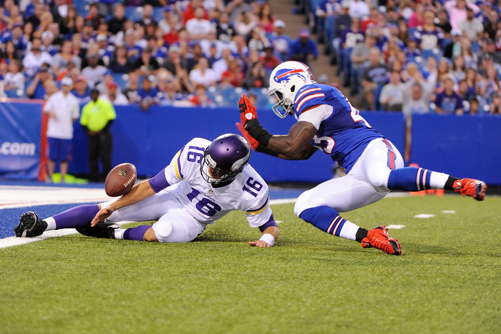 . Minnesota Vikings quarterback Matt Cassel (16) attempts to recover his fumble as Buffalo Bills\' Bryan Scott (43) chases him during the first half of an NFL preseason football game Friday, Aug. 16, 2013, in Orchard Park, N.Y. Bills\' Jamie Blatnick recovered the ball in the end zone for a touchdown. (AP Photo/Gary Wiepert)