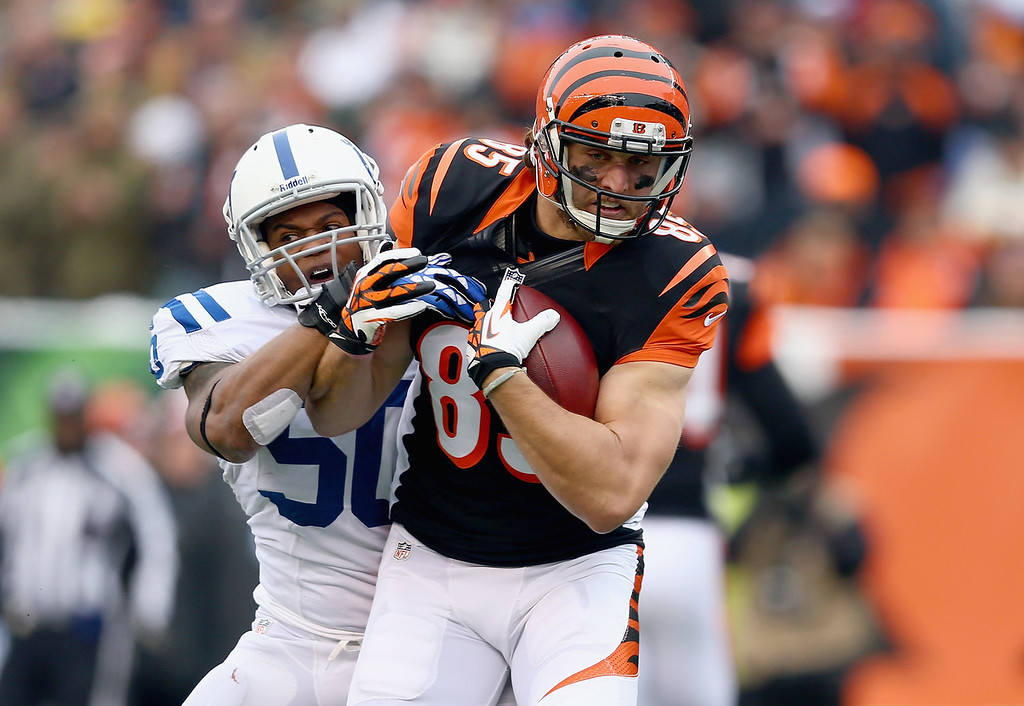 . Tyler Eifert #85 of the Cincinnati Bengals runs with the ball while defended by Jerrell Freeman #50 of the Indianapolis Colts during the NFL game at Paul Brown Stadium on December 8, 2013 in Cincinnati, Ohio.  (Photo by Andy Lyons/Getty Images)