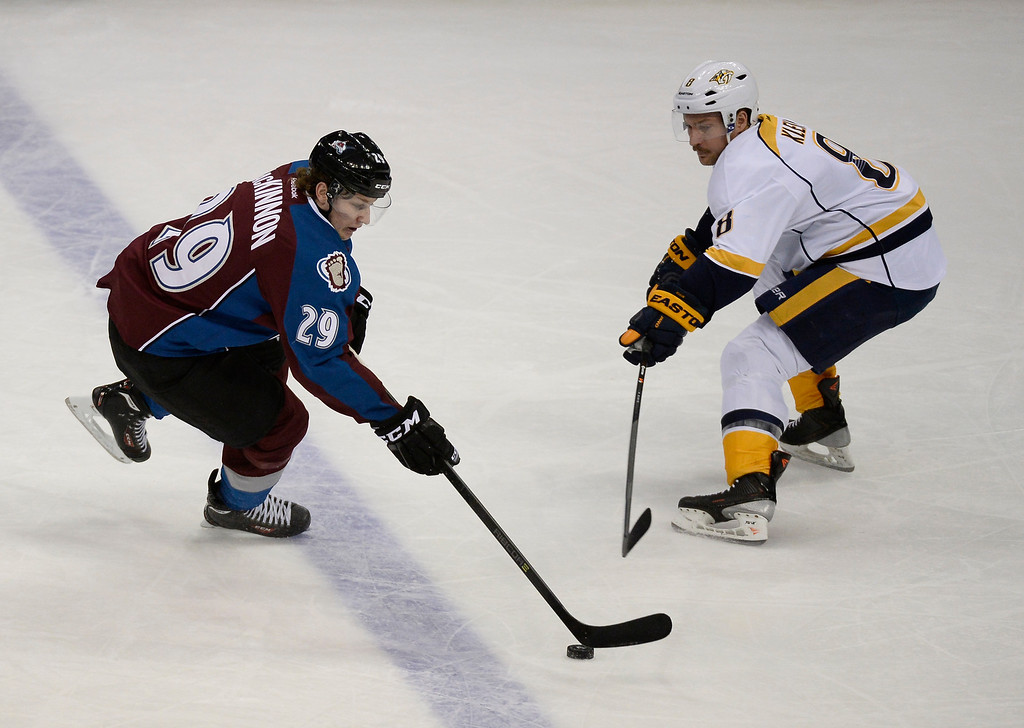 . Colorado Avalanche center Nathan MacKinnon (29) skates the puck in on Nashville Predators defenseman Kevin Klein (8) during the second period November 6, 2013 at Pepsi Center. (Photo by John Leyba/The Denver Post)