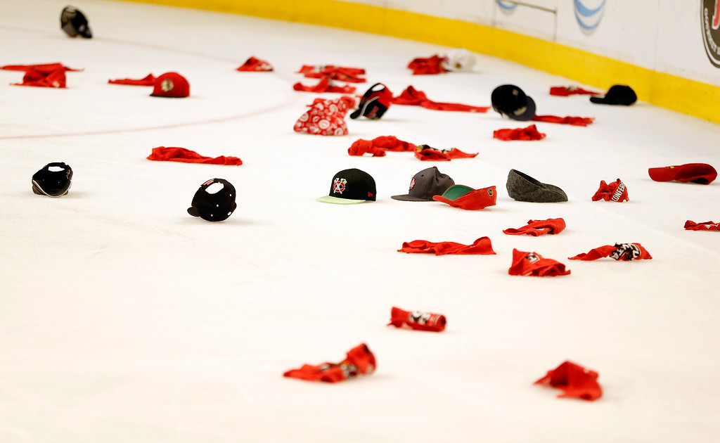 . CHICAGO, IL - JUNE 08:  A detail of hats on the ice after Patrick Kane #88 of the Chicago Blackhawks scored the game-winning goal in the second overtime to give him a hat trick for the game against the Los Angeles Kings during Game Five of the Western Conference Finals of the 2013 NHL Stanley Cup Playoffs at United Center on June 8, 2013 in Chicago, Illinois.  (Photo by Gregory Shamus/Getty Images)