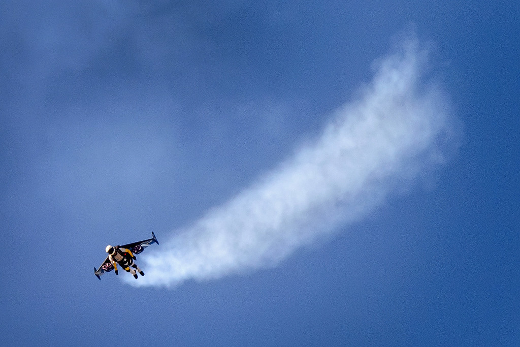 """. Swiss pilot Yves Rossy known as the \""""Jetman\"""" flies with his jet-powered 2 meters wingspan wing attached to his back during the first day of AIR14 air show on August 30, 2014 in Payerne, western Switzerland. The airshow commemorates over two week-ends the 100th anniversary of the Swiss Air Forces.  AFP PHOTO / FABRICE COFFRINI/AFP/Getty Images"""