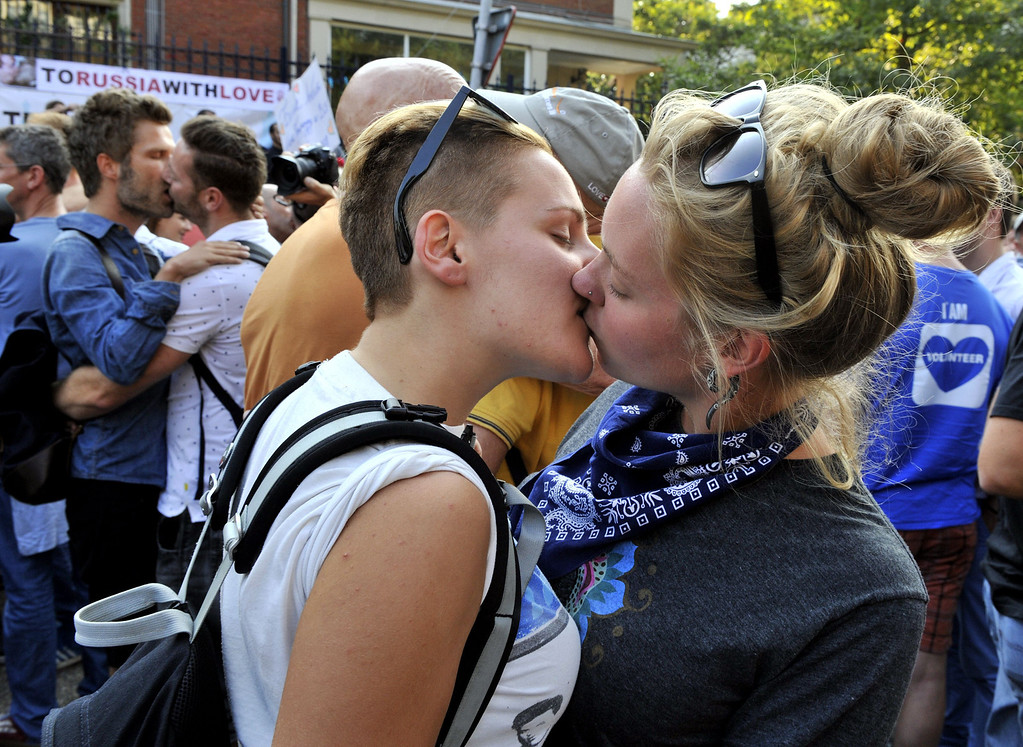 """. A lesbian couple kisses as they participate in a  \'Kiss-In\' action at the Russian consulate in Antwerp to protest against the treatment of lesbian, gay, bisexual and transgender oriented people in Russia on August 9, 2013.  Russia on Friday said it was unperturbed by threats of an Olympic boycott over a controversial law banning \""""homosexual propaganda\"""", despite wide-ranging criticism of the legislation from athletes to US President Barack Obama. GEORGES GOBET/AFP/Getty Images"""