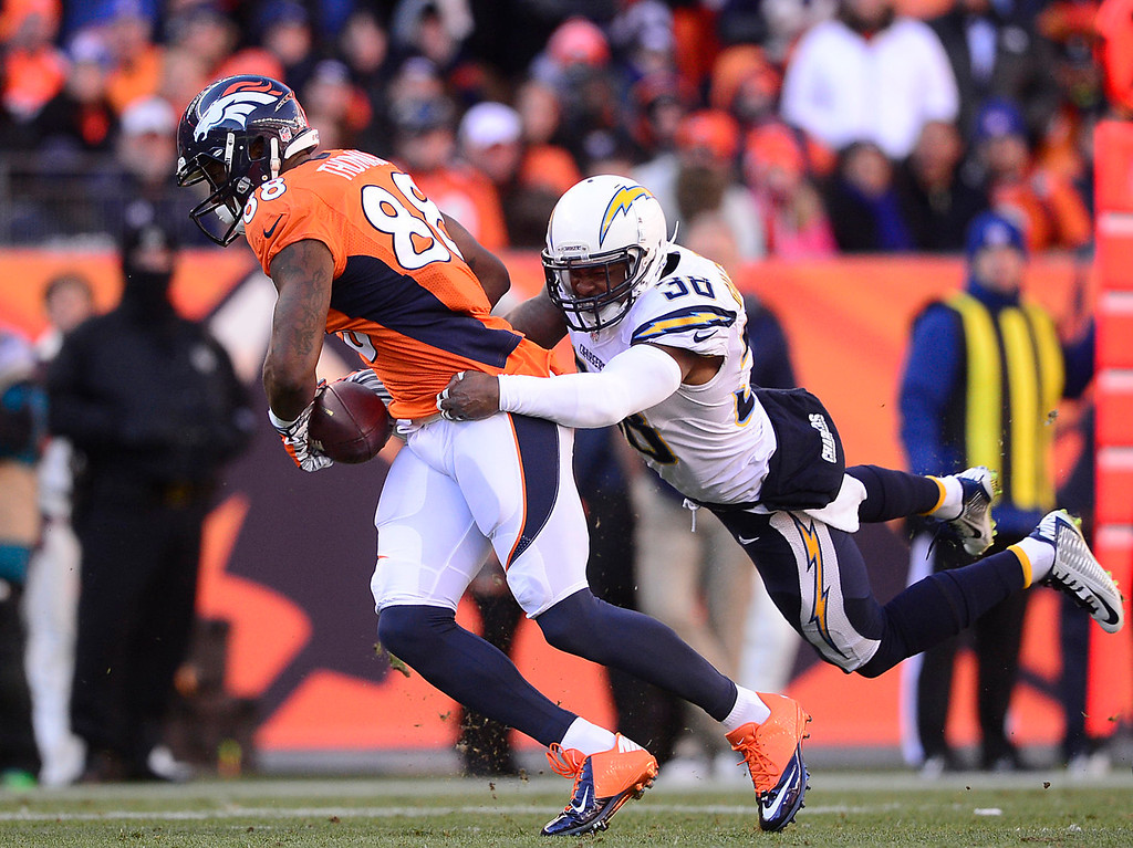 . Denver Broncos wide receiver Demaryius Thomas (88) makes a first down  catch in the first quarter. The Denver Broncos take on the San Diego Chargers at Sports Authority Field at Mile High in Denver on January 12, 2014. (Photo by AAron Ontiveroz/The Denver Post)