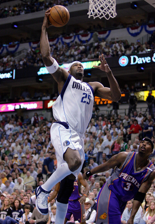 . 1996: Erick Dampier (No. 10) Center Erick Dampier #25 of the Dallas Mavericks goes for the slam dunk against Quentin Richardson #3 of the Phoenix Suns in Game three of the Western Conference Semifinals during the 2005 NBA Playoffs at the American Airlines Center on May 13, 2005 in Dallas, Texas.  (Photo by Ronald Martinez/Getty Images)