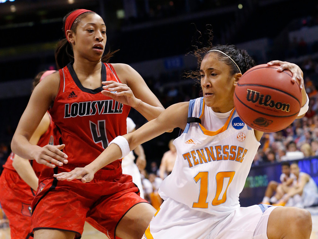 . Tennessee guard Meighan Simmons (10) drives around Louisville guard Antonita Slaughter (4) in the first half of the Oklahoma City regional final in the NCAA women\'s college basketball tournament in Oklahoma City, Tuesday, April 2, 2013.  (AP Photo/Sue Ogrocki)